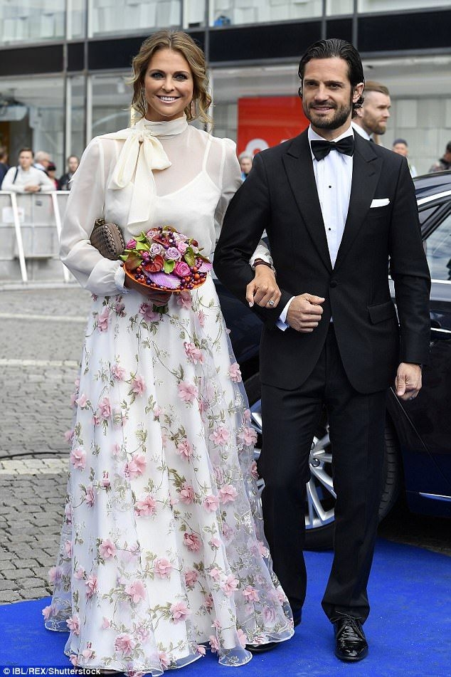 Princess Madeleine, 34, looked ethereal in a long white gown embellished with a 3D floral motif, while Crown Princess Victoria, 39, wore an unusual ruched silver gown.
