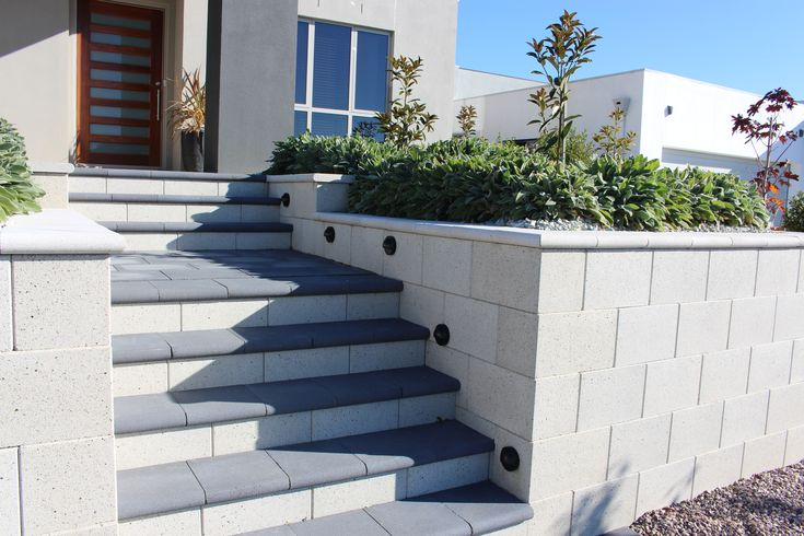 Modern entrance into a new home using Freestone ECO Retaining Wall blocks and feature lighting