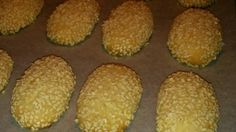 After trying my hand at countless sesame cookie recipes, my Italian girlfriend shared her Aunt Anne's recipe and I knew my search had ended! Basically an anise flavored butter cookie covered in sesame seeds. The smell when removing them from the oven is wonderful!