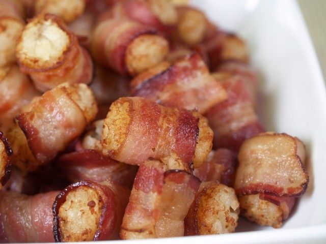 Bacon Wrapped Tater Tots - CDKitchen.com -  A truly indulgent treat! Tator tots are wrapped in bacon and baked until crispy. Great as an appetizer or side dish. Bet you can't eat just one!
