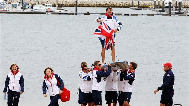 Nick Dempsey of Great Britain is carried onshore on his windsurf board by Team GB team mates after winning the silver medal in the RS-X men's Sailing on Day 11 of the London 2012 Olympic Games at the Weymouth and Portland venue  /Photo/sport/General/01/37/62/341nick-dempsey-great-britain-carried-onshore-his-windsurf-board-team-team-mates1376234  Related tags