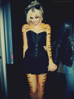cute halloween costume idea. Just have to find someone who knows how to paint the tiger pattern, as good as hers is.