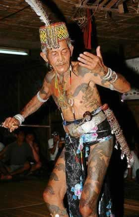 An Iban tribesmember performing a traditional dance in Sarawak, Malaysia