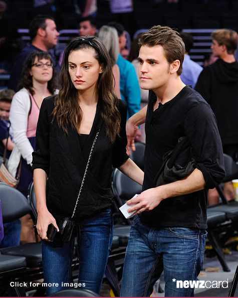 Phoebe Tonkin (L) and Paul Wesley attend a basketball game between the Atlanta Hawks and the Los Angeles Lakers at Staples Center on March 15, 2015 in Los Angeles, California. (Photo by Noel Vasquez/GC Images)