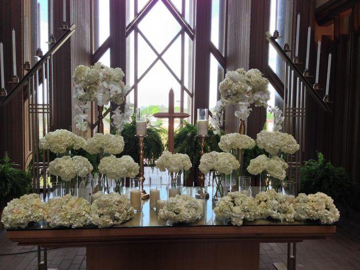 Flowers on altar at wedding at the Marty Leonard Chapel www.TexasHarp.com