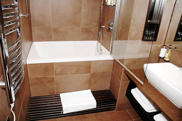 Calyx deep soaking bath a calyx 1230 shown with a for Small bathroom design for elderly