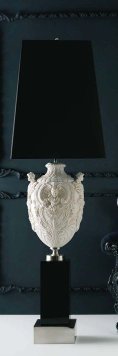 Contemporary lamp with ornate classical urn details.