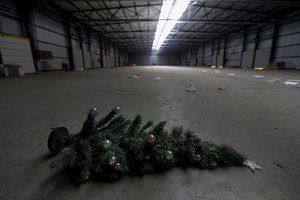 A christmas tree lies on the floor of a logistics and international transportation company that closed in 2012 in Thessaloniki
