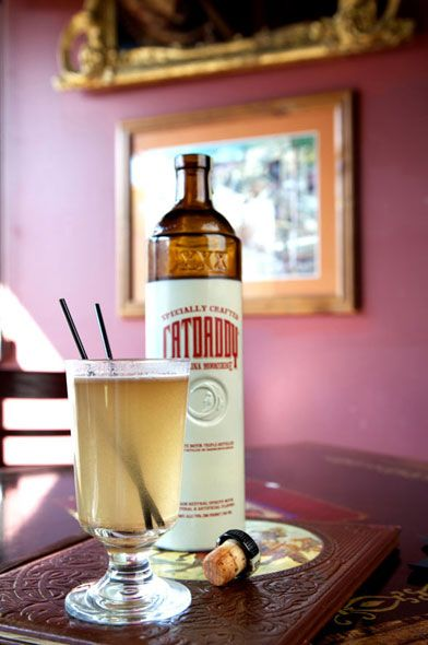 Hot Buttered Moonshine at Surly Girl Saloon: 1 tsp. butter, cold or room temperature, mixed with brown sugar to taste and pinches of cinnamon, cloves and nutmeg, 8-10 oz. hot water, 1.5 oz. Catdaddy Carolina Moonshine