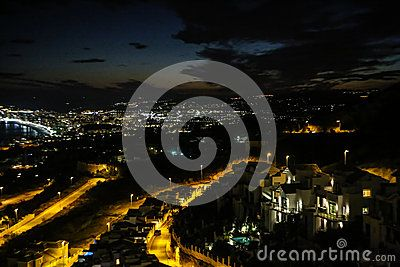 Aerial night view of Benalmadena  Spain Andalucia from Stupa. Dramatic sky, lighted streets. Picture taken in december 2015.