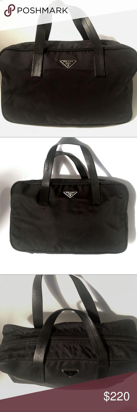"Black Nylon Prada handbag Black nylon Prada satchel, in great condition, used slightly. No flaws. Originally bought at off Saks. any questions please ask. Measures: L:13""  H:8"" Gusset Width:4.5"" strap drop:5"" Prada Bags"