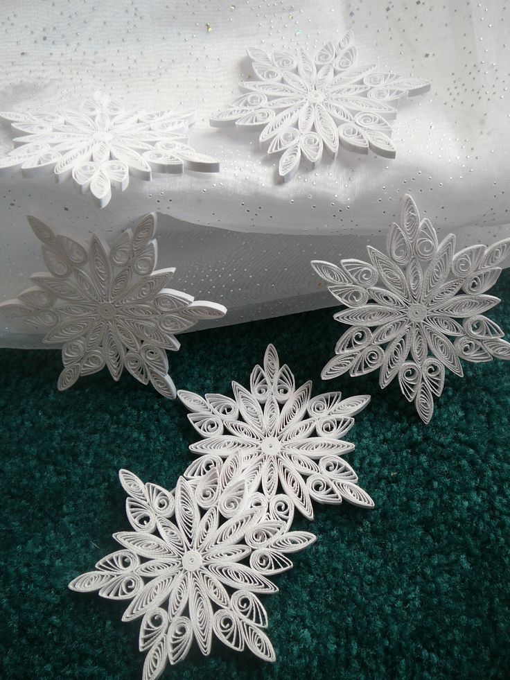 Paper Quilled Snowflakes  https://www.etsy.com/listing/203979487/paper-quilled-christmas-frozen-snowflake?