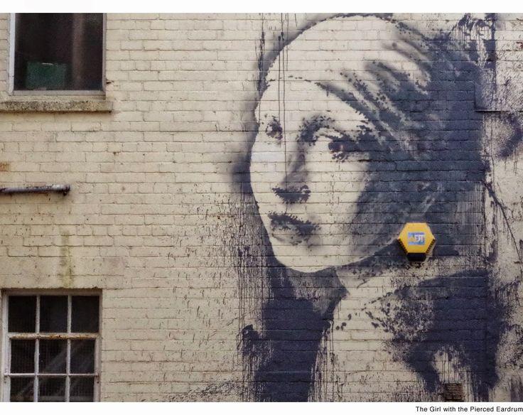 """Banksy returns: """"The girl with pierced eardrum"""" based on Vermeer, Bristol (UK)"""