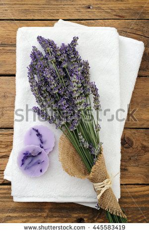 bunch of fresh lavender flowers and soap on a white towel background  - stock photo