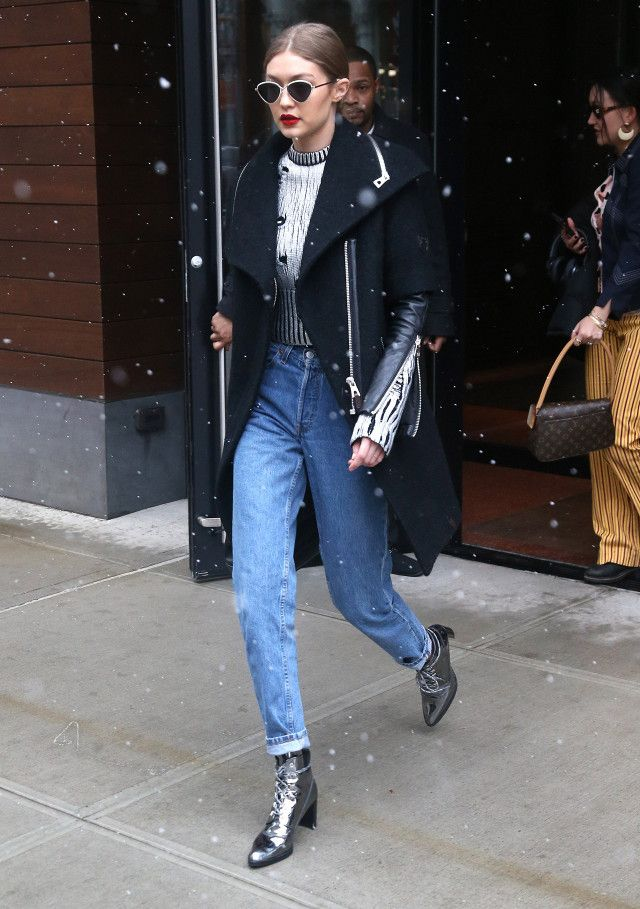 Gigi Hadid wearing silver ankle boots