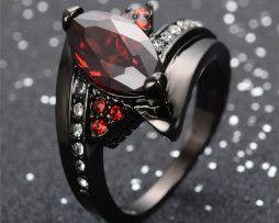 Luxusný dámsky prsteň zo zliatiny tmavého zlata s rubínmi