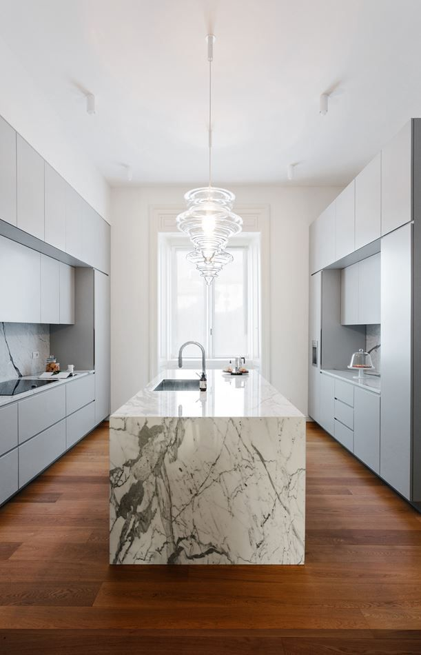 Grey cabinetry and marble