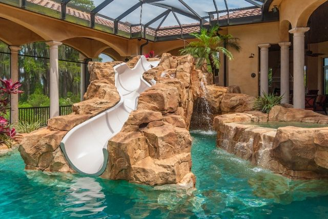"""custom resort-style swimming pool complete with waterslide and lazy river"""