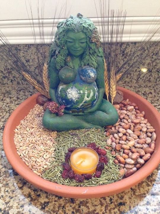 Having a kitchen altar can help to keep your energy up while you cook! It could be anything from a favorite scented candle to a statue of a favorite goddess (in this case, Gaia) or a vase of flowers. Great creative and add a little magic to your kitchen!