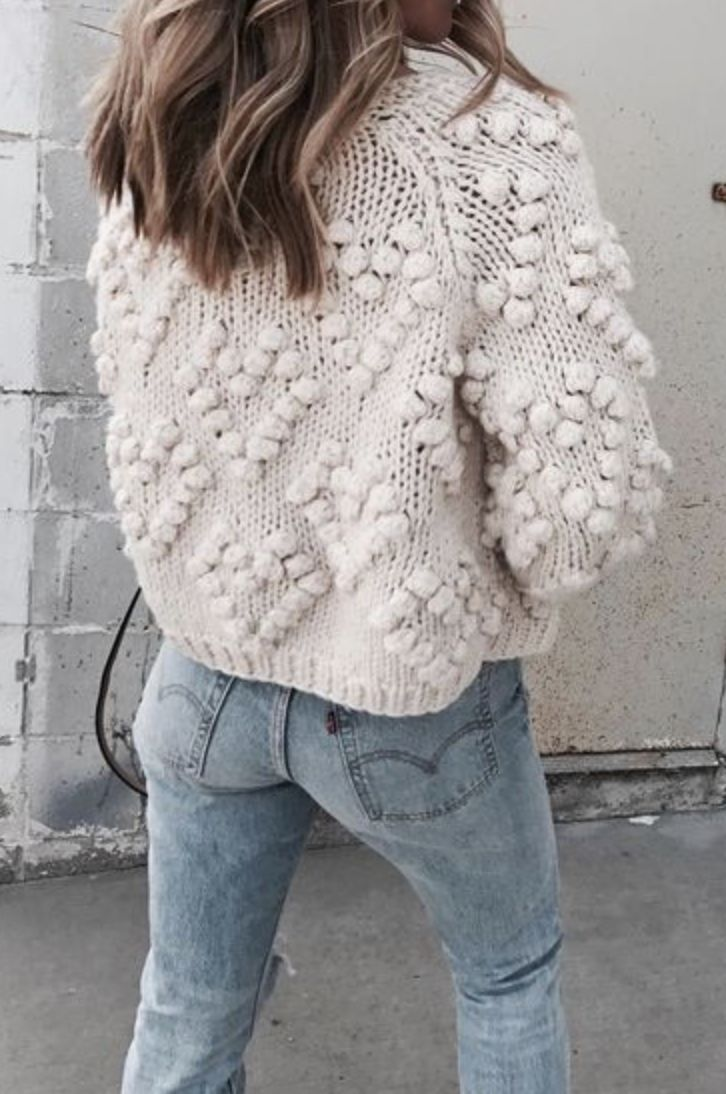 {White textured sweater and denim.}