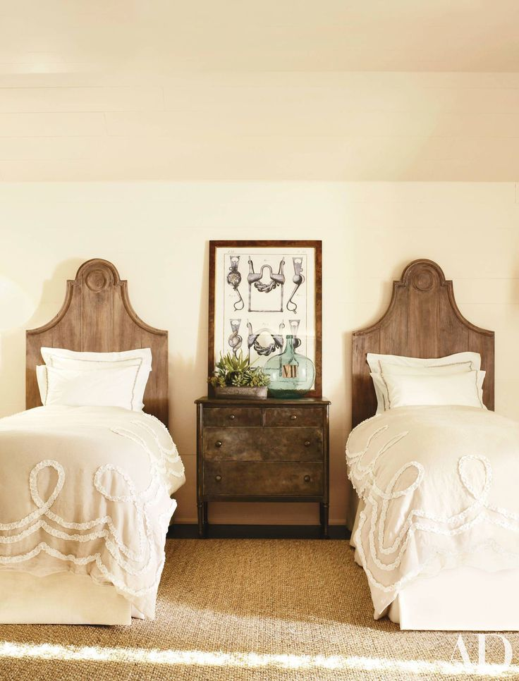 This Atlanta home features beautiful twin beds that are perfectly symmetrical.