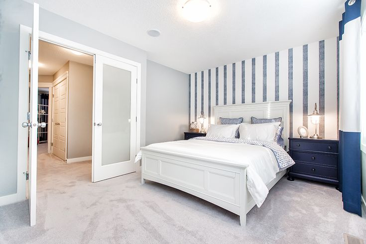 I just want to flop down on this bed; beautiful master bedroom and love those French doors!