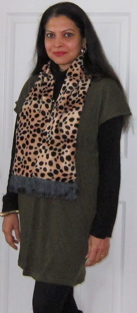 Faux fur scarf dresses up an olive drab dress by LabelRituKumar over Uniqlo fleece turtleneck, opaque tights and boots