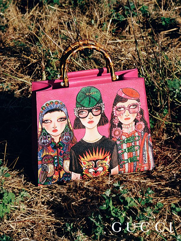 Looking at the Unskilled Worker campaign, shot by Clara Balzary and art directed by Christopher Simmonds on a lake outside of Rome. Defining Gucci accessories by Alessandro Michele feature the artist Unskilledworker's artworks, including the Gucci Nymphea bag.