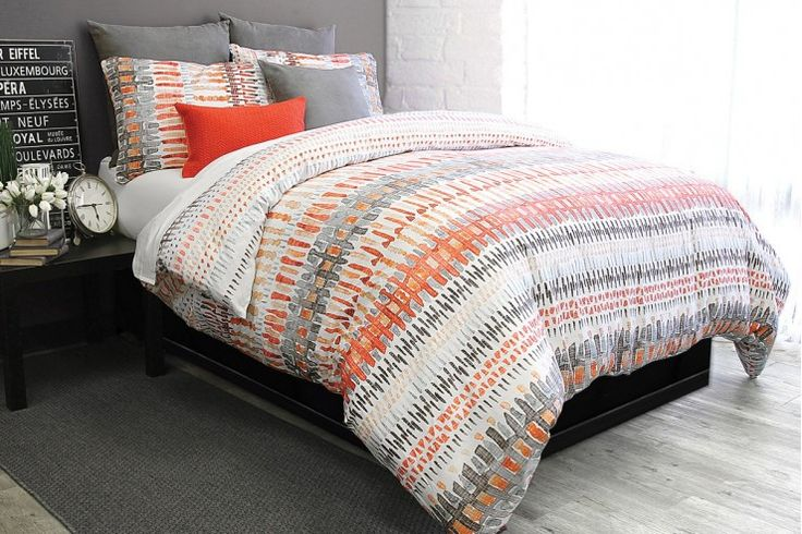 Copley's vibrant color and graphic attitude come together in a splendid bang. Unique pattern in shades of bleached rust, wine, ash, aqua and taupe looks unexpected in all the right ways! 100% Cotton sateenReversible print220 Thread countShown with Javier grey and Bouclé decorative cushion
