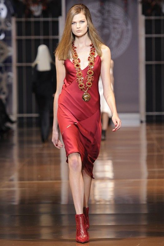 Versace RTW Fall 2014 - Designer remove the boundaries of street dress and lingerie. Intense red color, silk sleeveless dress is highly seductive.
