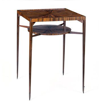 This Spider Table was designed by Émile-Jacques Ruhlmann (France) between 1918 and 1920 and was produced in 1929. It is composed of Ebony wood and Ivory inlay and gets its name from its spider-like narrow frame.
