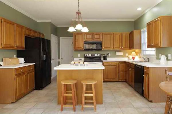 appealing light green kitchen walls white cabinets | designer kitchen with oak cabinets and black granite ...