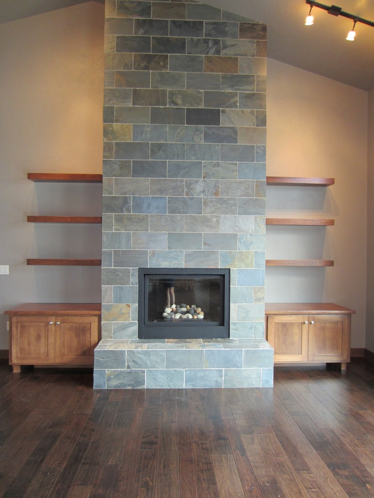 Slate fireplace, birch hand-scraped floor