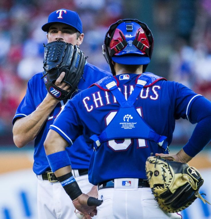 Texas Rangers starting pitcher Cole Hamels (35) has a word with catcher Robinson Chirinos (61) on the mound during the second inning of their game against the Cincinnati Reds on Wednesday, June 22, 2016 Globe Life Park in Arlington, Texas. (Ashley Landis/The Dallas Morning News)