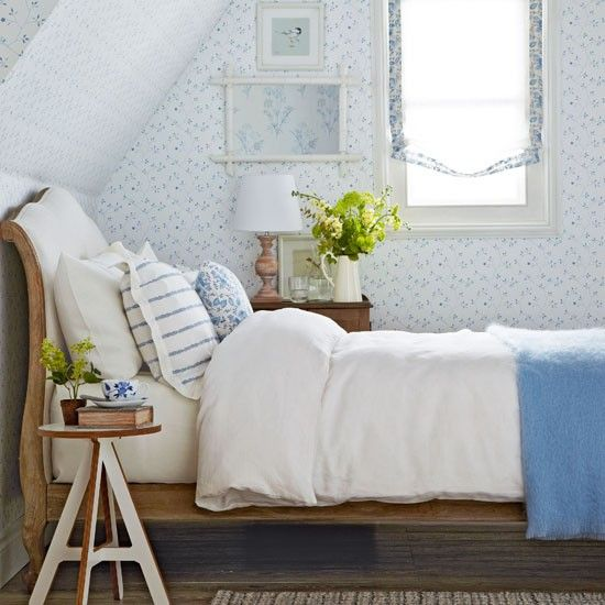 "Using whites and blues with the ""soot"" (sand-colored) duvet might evoke the ocean, or at least look similar to the ""classic blue and white bedroom."" Maybe consider a lighter stain than originally planned??"