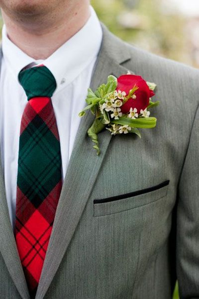 Love the tie.  Would change the greens in the boutoniere to Christmas greens so that they match the tie color better.