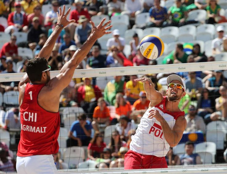 Grzegorz Fualek of Poland hits a shot against against the block Marco Grimalt of Chile in a men's preliminary - Pool E match at the Beach Volleyball Arena during the Rio 2016 Summer Olympic Games.     -  Best images from Aug. 11 at the Rio Olympics