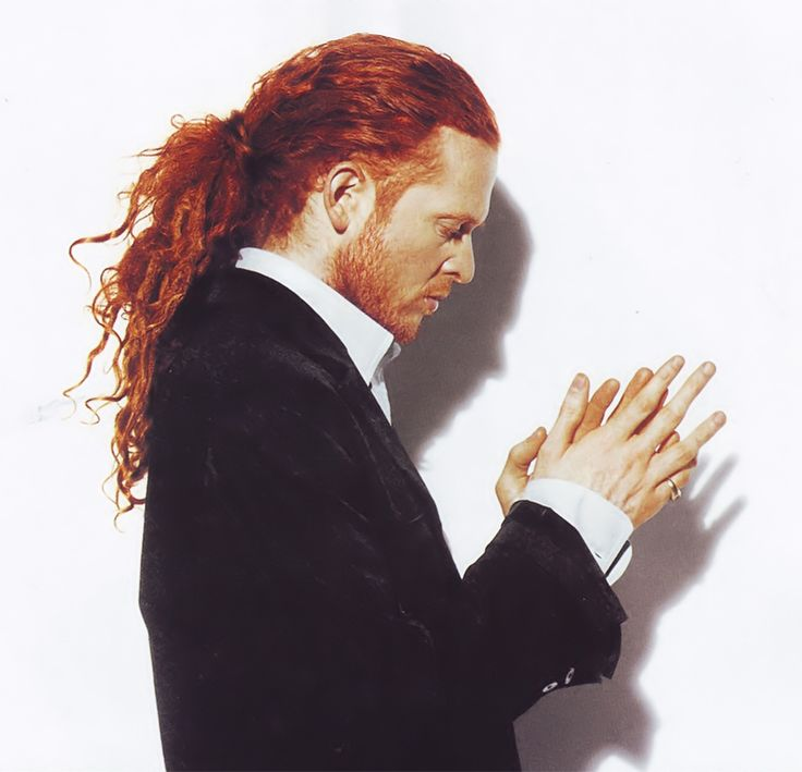 red-headed English singer songwriter, Mick Hucknall of British soul band Simply Red simplyred.com. My cousins toured with him look up Steve Lewinson ( band leader/ bass guitarist) and Pete Lewinson (drummer)