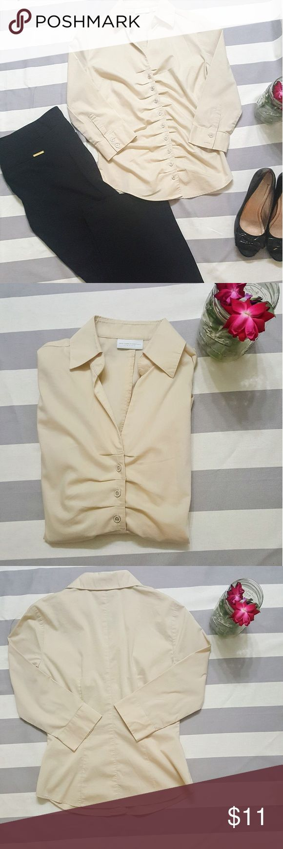 New York & Company stretch button down! XS. This neutral blouse is great for work! Wear it with dress pants or a nice pencil skirt. It's very versatile! It's in like new condition. It's a light cream color and size is XS. It's stretchy and comfortable! There are bunching detail around the buttons. Made with 60% Cotton, 35% Polyester and 5% Spandex.   Measurements  Pit to pit- 18 inches  Length from top of shoulder to bottom- 23 inches  Thanks for looking, don't forget to bundle! New York…