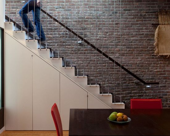 http://www.zubujk.com/wp-content/uploads/2014/04/unique-cable-banister-railings-as-modern-staircase-design-ideas-look-at-that-extraordinary-railings-bricks-wall-white-under-stairs-storage-brown-dining-table-with-red-chairs-staircase-designs.jpg