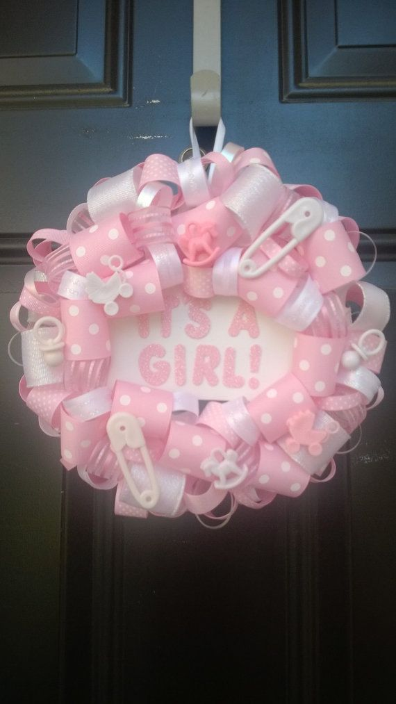 "It's a GIRL 8"" Ribbon Wreath with pink and white ribbon, pacifiers, safety pins, baby buggy and rocking horse; hospital door decoration on Etsy, $28.00"