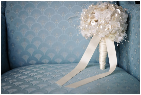Ivory button bouquet with feathers by Debbie Carlisle www.dcbouquets.co.uk