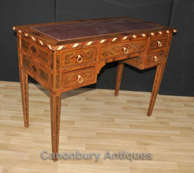 - Gorgeous Regency style knee hole desk in walnut with intricate marquetry inlay<BR> - Stylish piece, really eye catching, particularly with the interplay between different coloured woods of marquetry inlay<BR> - Five drawers to the front so lots of storage<BR> - Top is finished in red tooled leather with gilded motifs to the edge<BR> - Make for a great home office desk, very comfortable to sit at<BR> - If this desk is not suitable we have a whole range of other desks - Victorian desks…