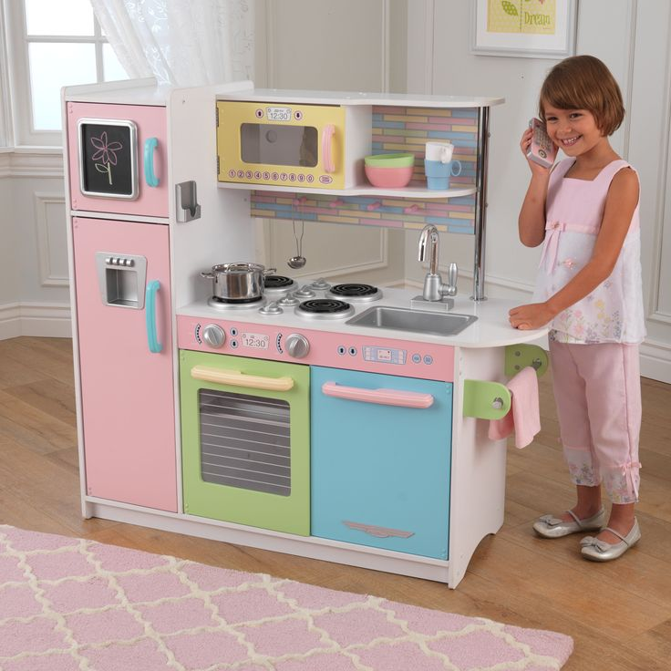 Cook up some fun with this pastel KidKraft kitchen. Details like a cordless phone and a chalkboard make kids feel like they're in an actual kitchen.