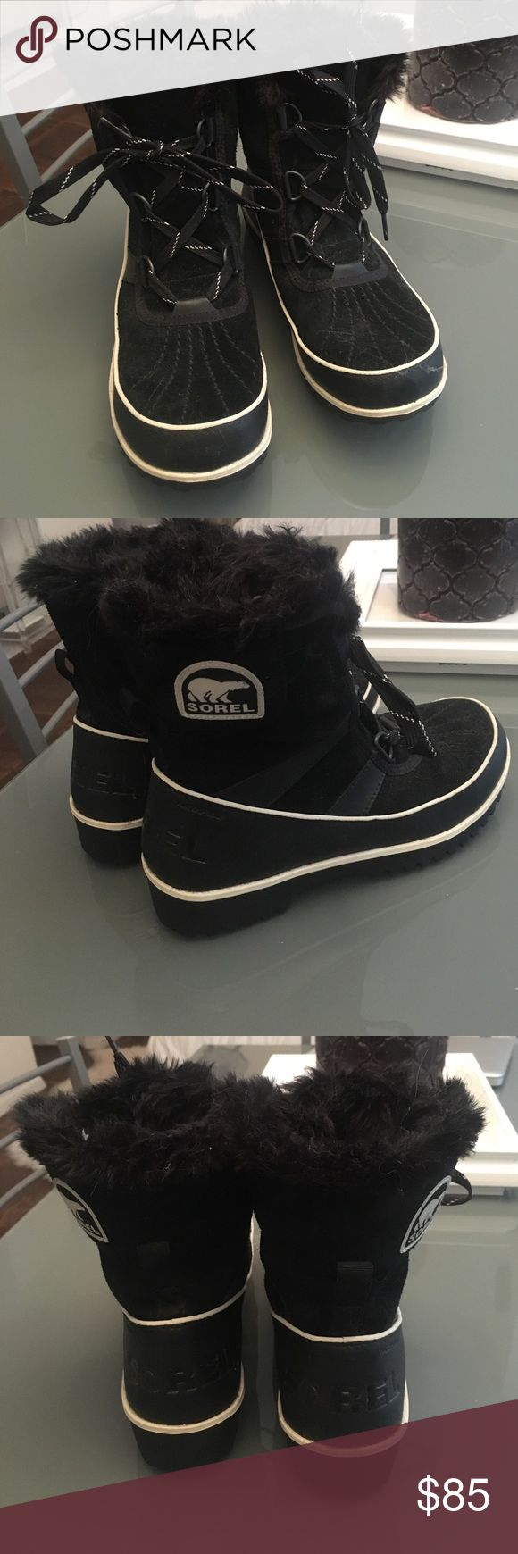 Black Sorel snow booties Fur lined lace up Sorel boots. So cute worn only a few times.  Size 7 NWOT SALE!!! NEED TO CLEAN OUT MY SHOE CLOSET Sorel Shoes Winter & Rain Boots