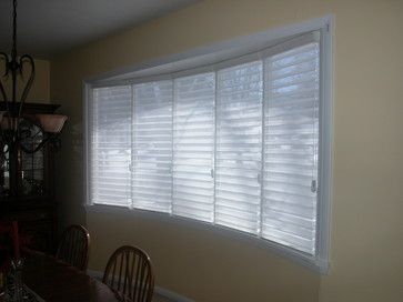 Horizontal sheers, like silhouettes, in a bow window ...good pic!  bow window treatments | Big Bow Window - philadelphia - by Blinds & Designs