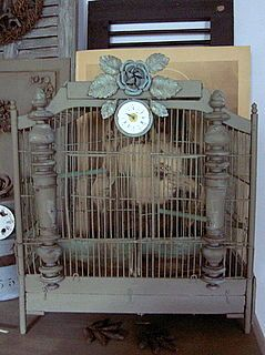 Birdcage embellished with rose and clock