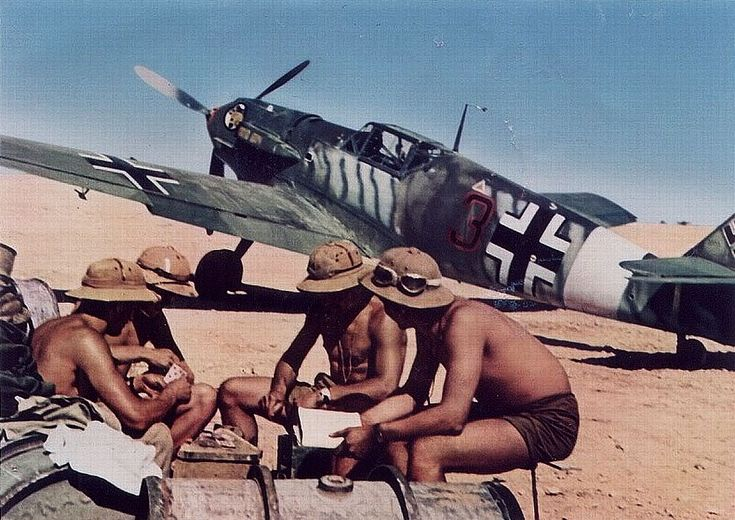 Crew of a Bf 109 fighter in North Africa, date unknown.