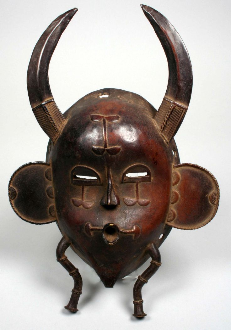 Africa | Face mask from the Senufo people, northern Ivory Coast | Bronze, copper | ca. 1950s