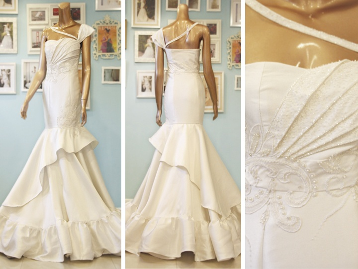 Mermaid / trumpet wedding dress by Camille Garcia with asymmetrical details and touchesof beadwork.